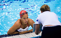 26 JUL 2012 - LONDON, GBR - Synchronised Swimmer Jenna Randall (GBR) of Great Britain watches a playback of her practicing her routine at the Aquatics Centre in the Olympic Park, Stratford, London, Great Britain ahead of the start of the London 2012 Olympic Games (PHOTO (C) 2012 NIGEL FARROW)