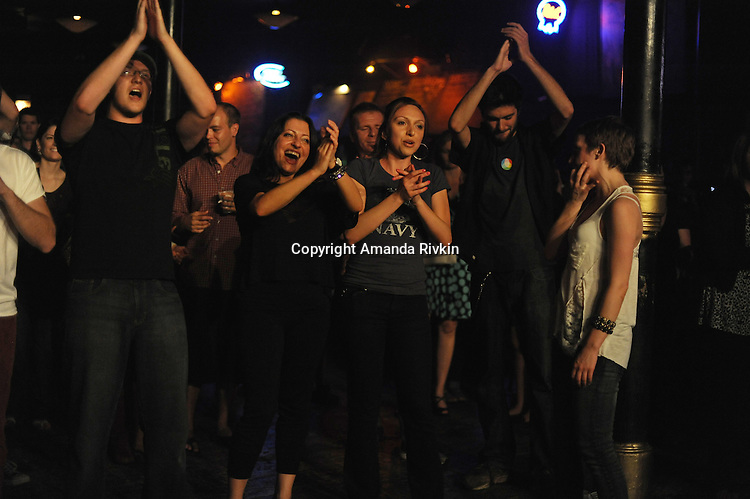Audience members dance and react enthusiastically after a live set by Pet Peeve at the Double Door in Chicago, Illinois on June 5, 2011.