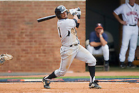 Richard Gonzalez #11 of the VCU Rams follows through on his swing against the Virginia Cavaliers at the Charlottesville Regional of the 2010 College World Series at Davenport Field on June 4, 2010, in Charlottesville, Virginia.  The Cavaliers defeated the Rams 14-5.  Photo by Brian Westerholt / Four Seam Images