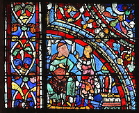 The younger son demands his inheritance from his father, from the Parable of the Prodigal Son stained glass window, in the north transept of Chartres Cathedral, Eure-et-Loir, France. This window follows the parable as told by St Luke in his gospel. It is thought to have been donated by courtesans, who feature in 11 of the 30 sections. Chartres cathedral was built 1194-1250 and is a fine example of Gothic architecture. Most of its windows date from 1205-40 although a few earlier 12th century examples are also intact. It was declared a UNESCO World Heritage Site in 1979. Picture by Manuel Cohen