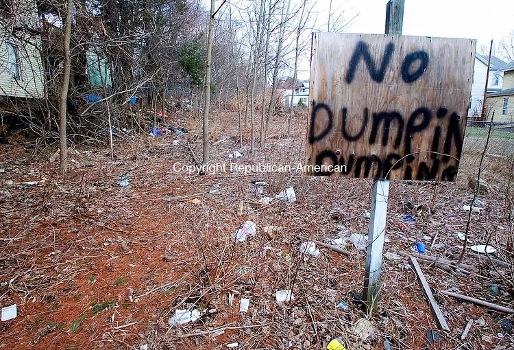 WATERBURY, CT. 10 April 2007-041007SV04--No Dumping sign sits among garbage on Bronson Street in Waterbury.<br /> Steven Valenti Republican-American
