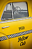 Rear door of a vintage 1950 Yellow Cab automobile.