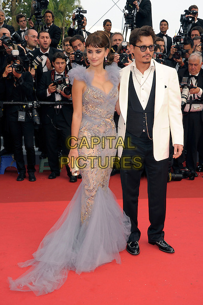 PENELOPE CRUZ, JOHNNY DEPP.Attending the 'Pirates of the Caribbean: On Stranger Tides' premiere, Palais des Festivals during the 64th International Cannes Film Festival, Cannes, France,.14th May 2011..4 four full length black trousers white  jacket suit white waistcoat tuxedo tux blue dress fishtail tulle  grey gray beige beaded silver cream clutch bag ruffle shoulders .CAP/PL.©Phil Loftus/Capital Pictures.