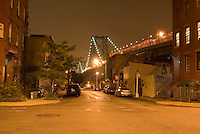 Street Scene at Night in the Williamsburg Neighborhood of Brooklyn, Williamsburg Bridge in the background, New York City, New York City, USA