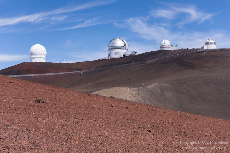 Mauna Kea, Big Island of Hawaii, Hawaii; a view of the (left to right) Canada-France-Hawaii Telescope, Gemini Northern 8-meter Telescope, UH 2.2-meter Telescope and United Kingdom Infrared Telescopes at the summit of the Mauna Kea Observatories (MKO), currently there are 13 independent multi-national astronomical research facilities located on the summit. Mauna Kea's altitude and isolation in the middle of the Pacific ocean make it an ideal location for astronomical observation.