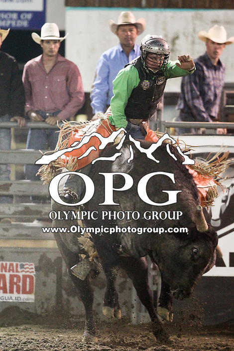 20 Aug 2014:  Reid Barker scored a 81 in the first round of the Seminole Hard Rock Extreme Bulls competition at the Kitsap County Stampede in Bremerton, Washington.
