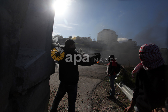 Palestinian protesters throw stones at Israeli soldiers during clashes in front of Ofer prison, near the West Bank city of Ramallah, following a demonstration in support of Palestinian detainee, Samer Issawi, who has been on hunger strike for more than 200 days, and other prisoners on hunger strike in Israeli prisons on February 15, 2013. A United Nations official on February 13, expressed concern about the wellbeing of Palestinian detainees in Israeli prisons and in particular about the condition of Issawi. Photo by Issam Rimawi