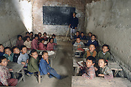September, 1985. Shaanxi Province, China. The caves of Yan'an are more than 500 years old and still provide shelter for the farmers, including this elementary school.