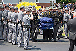 Trooper Eric Keith Chrisman was laid to rest Monday June 29, 2015 in Lawrenceburg, Ky.  Officers from across Kentucky and the Nation came to pay respects to his family.  Photo by Mark Mahan
