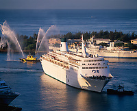 Cruise Ship with Fireboat Water Greeting, Aloha Tower Marketplace, Honolulu, Oahu, USA.