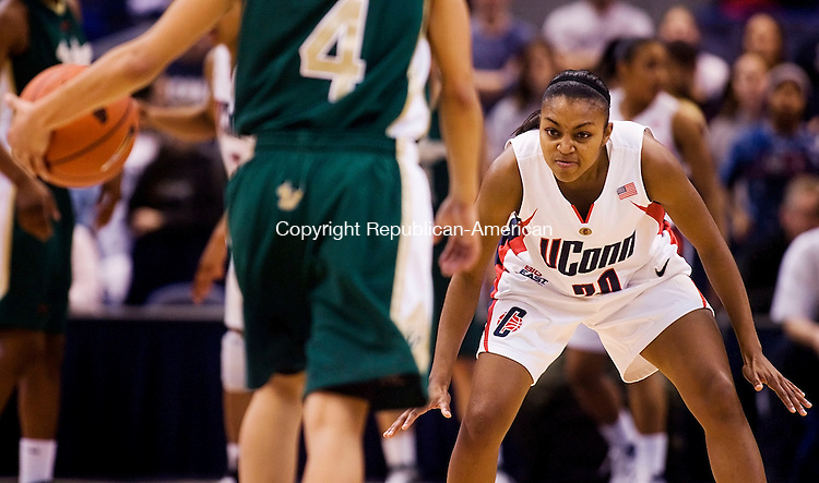 HARTFORD--30 January 07--013008TJ06 - UConn's Renee Montgomery (20) shows her game face as South Florida's Jazmine Sepulveda (4) brings the ball into play during UConn's 71-48 win against the University of South Florida at the XL Center in Hartford, Conn., on Wednesday, January 30, 2008. (T.J. Kirkpatrick/Republican-American)