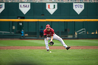 Bobby Wernes (7) of the Arkansas Razorbacks fields during a game between the Virginia Cavaliers and Arkansas Razorbacks at TD Ameritrade Park on June 13, 2015 in Omaha, Nebraska. (Brace Hemmelgarn/Four Seam Images)