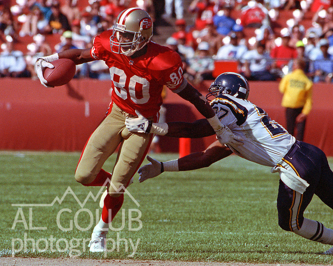 San Francisco 49ers vs. San Diego Chargers at Candlestick Park Sunday, September 8, 1991.  49ers beat Chargers 34-14.  Charger defensive back Donald Frank (27) tackles 49er wide receiver Jerry Rice (80).