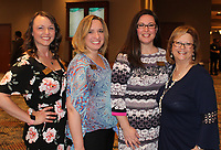 NWA Democrat-Gazette/CARIN SCHOPPMEYER Katlyn Taylor(cq) (from left), Twyla Rownak, Shauna Mauk and Renee Hutton welcome guests to the Corporate Luncheon on May 1.