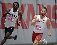 NWA Democrat-Gazette/ANDY SHUPE<br /> Arkansas' Kristopher Hari (right) competes Saturday, Feb. 9, 2019, in the 200 meters during the Tyson Invitational in the Randal Tyson Track Center in Fayetteville. Visit nwadg.com/photos to see more photographs from the meet.