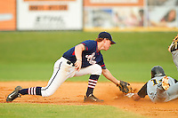 High Point-Thomasville HiToms shortstop Sam Foy #10 (Davidson) attempts to tag a Wilson Tobs runner at second base at Finch Field on June 17, 2013 in Thomasville, North Carolina.  The Tobs defeated the HiToms 3-2 in 11 innings.  Brian Westerholt/Four Seam Images