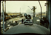 View from tender of a D&amp;RGW K-28 with the phony diamond stack of the tender of D&amp;RGW #476 on dual gauge track in Alamosa.  Red Devil coal loader and pipe train in background.<br /> D&amp;RGW  Alamosa, CO