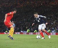 Jamie Mackie attacking Vanche Shikov in the Scotland v Macedonia FIFA World Cup Qualifying match at Hampden Park, Glasgow on 11.9.12. .