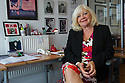 Edinburgh, UK. 25.08.2015. Karen Koren, founder and artistic director of the Gilded Balloon, in her office on Greenside Place, where she runs her empire from. The Gilded Balloon celebrates its 30th anniversary this year. Photograph © Jane Hobson.