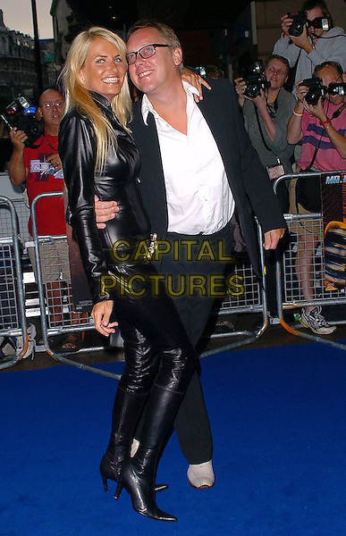 "NANCY SORRELL & VIC REEVES.At the UK Film Premiere of ""Fantastic Four"",.Vue Cinema, Leicester Square, .London, July 18th 2005..full length  black leather catsuit boots married husband wife hugging funny.Ref: CAN.www.capitalpictures.com.sales@capitalpictures.com.©Can Nguyen/Capital Pictures."