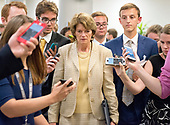 "United States Senator Lisa Murkowski (Republican of Alaska) is surrounded by reporters as she arrives in the US Capitol by the Senate Subway prior to the vote on the repeal of the Affordable Care Act (ACA) also known as ""Obamacare"" in Washington, DC on Wednesday, July 26, 2017.  The Senate voted 55-45 to reject legislation undoing major portions of President Barack Obama's signature healthcare law without a plan to replace it.<br /> Credit: Ron Sachs / CNP"