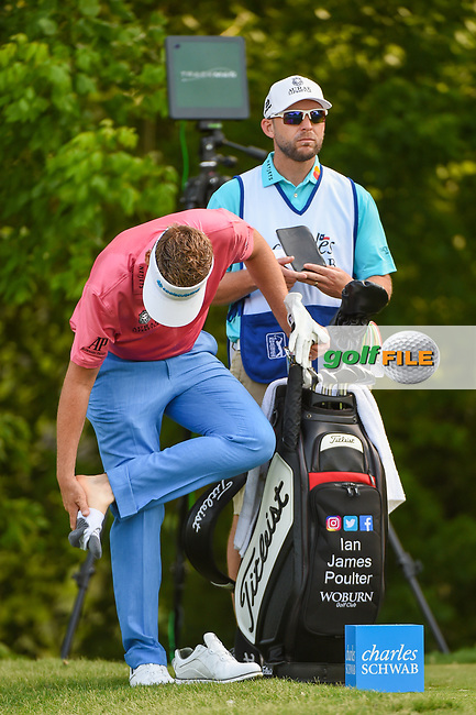 Ian Poulter (GBR) tends to his foot on the tee on 6 during round 3 of the 2019 Charles Schwab Challenge, Colonial Country Club, Ft. Worth, Texas,  USA. 5/25/2019.<br /> Picture: Golffile | Ken Murray<br /> <br /> All photo usage must carry mandatory copyright credit (© Golffile | Ken Murray)