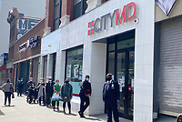 NEW YORK, NY - MAY 20: In Central Harlem, a line forms outside CItyMD which provides free coronavirus testing during the coronavirus pandemic in New York City on May 20, 2020. <br /> CAP/MPI/RMP<br /> ©RMP/MPI/Capital Pictures