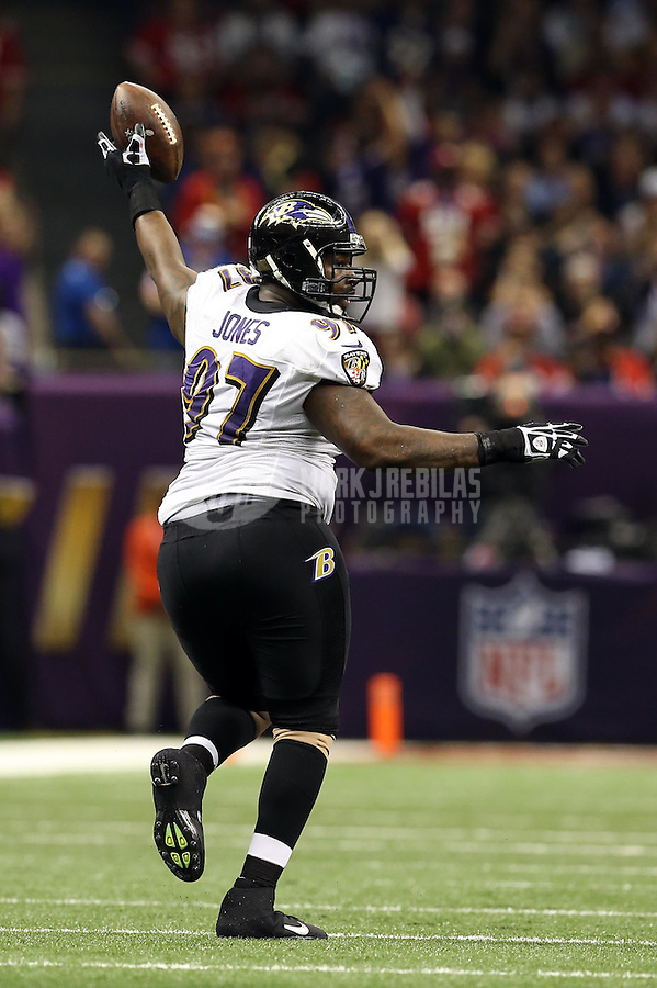 Feb 3, 2013; New Orleans, LA, USA; Baltimore Ravens defensive end Arthur Jones (97) reacts after recovering a fumble against the San Francisco 49ers in the second quarter in Super Bowl XLVII at the Mercedes-Benz Superdome. Mandatory Credit: Mark J. Rebilas-