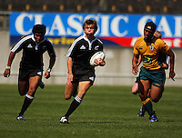 Ale Kotoni (right) chases as Rhys Llewellyn breaks with Julian Savea in support during the International rugby match between New Zealand Secondary Schools and Suncorp Australia Secondary Schools at Yarrows Stadium, New Plymouth, New Zealand on Friday, 10 October 2008. Photo: Dave Lintott / lintottphoto.co.nz