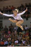 Oct 19, 2006; Aarhus, Denmark; Alina Kozich of Ukraine performs cossack jump on balance beam during women's gymnastics AA competition at 2006 World Championships Artistic Gymnastics.