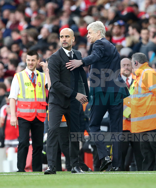 Arsenal's Arsene Wneger with Manchester City's Pep Guardiola at the final whistle during the Premier League match at the Emirates Stadium, London. Picture date: April 2nd, 2017. Pic credit should read: David Klein/Sportimage