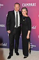 LOS ANGELES, CA. February 19, 2019: Betty Pecha Madden & Mike Miller at the 2019 Costume Designers Guild Awards at the Beverly Hilton Hotel.<br /> Picture: Paul Smith/Featureflash