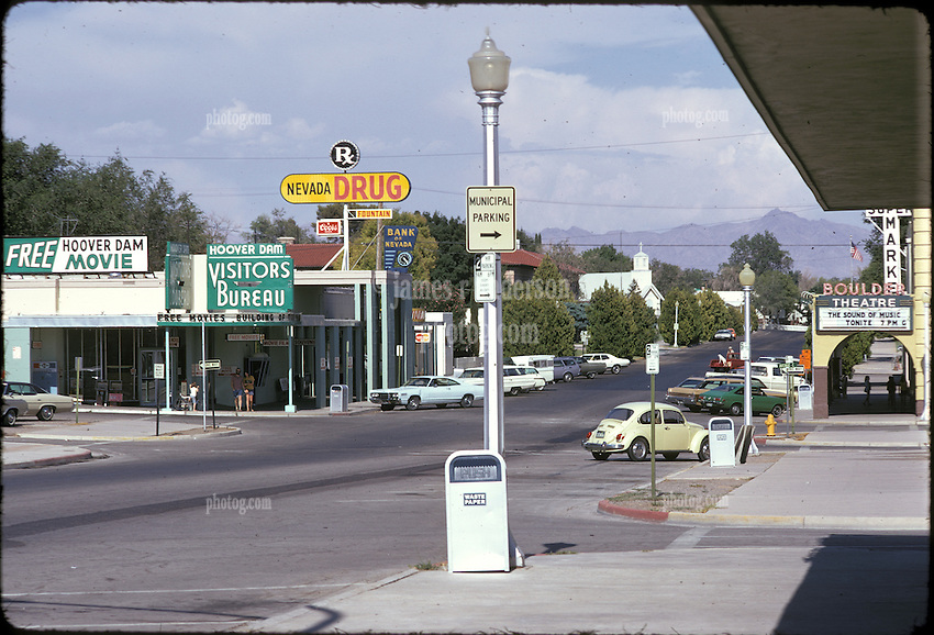 "Boulder City, Nevada as seen on a 1973 Road Trip. The main drag in town. ""Sound of Music"" on marquee as the film playing The Boulder Theater. Nikon Ftn Camera, 125th f/8 1/3 105mm f/2.5 lens, Kodachrome II."