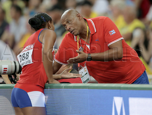 25.08.2015. Beijing, China.  Denia Caballero of Cuba  talks with her coach Raul Calderon Pozo (R) during the women's discus final of the Beijing 2015 IAAF World Championships at the National Stadium, also known as Bird's Nest, in Beijing, China, 25 August 2015.
