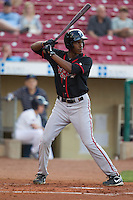 Lansing Lugnuts outfielder Carlos Ramirez #32 bats during a game against the Cedar Rapids Kernels at Veterans Memorial Stadium on April 29, 2013 in Cedar Rapids, Iowa. (Brace Hemmelgarn/Four Seam Images)
