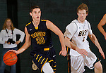 SPEARFISH, SD - DECEMBER 21, 2013:  Bryan Siefker #30 of Regis dribbles past Black Hills State defender Brody Brisk #4 during their Rocky Mountain Athletic Conference game Saturday at the Donald E. Young Center in Spearfish, S.D.  (Photo by Dick Carlson/Inertia)
