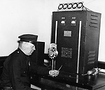 Waterbury Patrolman John McWeeney is shown sending out a message from Headquarters, Jun 1937