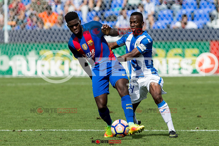 FC Barcelona's Aleix Vidal Club Deportivo Leganes's Mamadou Kone during the match of La Liga between Club Deportivo Leganes and Futbol Club Barcelona at Butarque Estadium in Leganes. September 17, 2016. (ALTERPHOTOS/Rodrigo Jimenez) /NORTEPHOTO