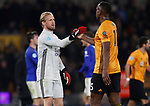 Kasper Schmeichel of Leicester City with Willy Boly of Wolverhampton Wanderers during the Premier League match at Molineux, Wolverhampton. Picture date: 14th February 2020. Picture credit should read: Darren Staples/Sportimage