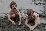 Playing in the mud of a pond in Stonewall, TX<br />