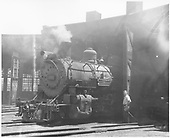 A D&amp;RGW K-37 poking its nose out of the Alamosa roundhouse.<br /> D&amp;RGW  Alamosa, CO