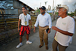 John Nduna (center), the general secretary of the ACT Alliance, talks with David Arias (left) and Romualdo Lozada, community leaders in Tolosa, a city in the Philippines province of Leyte that was hit hard by Typhoon Haiyan in November 2013. The storm was known locally as Yolanda. Christian Aid and other ACT Alliance members have been providing a variety of forms of assistance to survivors here, and Nduna and other ACT Alliance leaders spent several days in this and other affected communities learning first hand about the network's emergency response and long-term plans for recovery and rehabilitation.