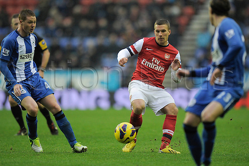 22.12.2012 Wigan, England.Lukas Podolski  of Arsenal  in action during the Premier League game between Wigan Athletic and Arsenal at the DW Stadium.