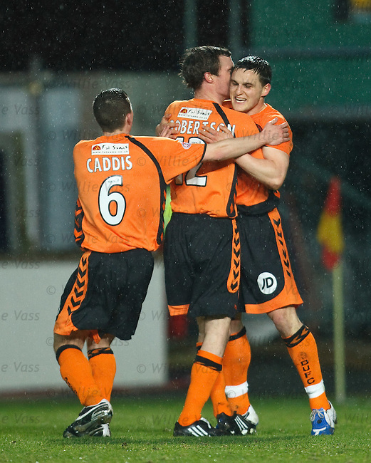 Craig Conway celebrates his penalty for Dundee utd