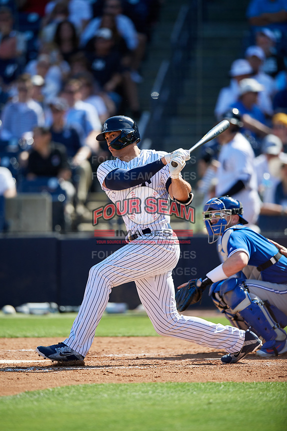 New York Yankees designated hitter Giancarlo Stanton (27) follows through on a swing during a Grapefruit League Spring Training game against the Toronto Blue Jays on February 25, 2019 at George M. Steinbrenner Field in Tampa, Florida.  Yankees defeated the Blue Jays 3-0.  (Mike Janes/Four Seam Images)