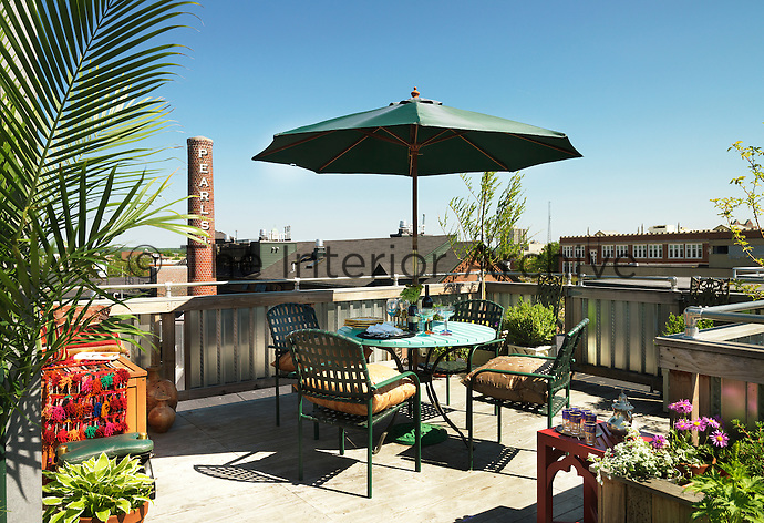 The rooftop dining space is set high amongst the chimneys with a view over the neighbouring buildings