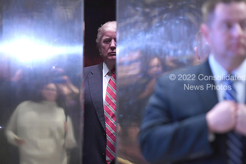 President-Elect Donald J. Trump is seen inside the lobby  elevator after meeting with Martin Luther King III (not pictured) of the Trump Tower in New York, NY, on January 16, 2017.<br /> Credit: Anthony Behar / Pool via CNP