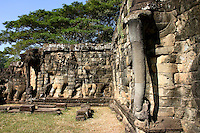 The Terrace of the Elephants is part of the walled city of Angkor Thom, a ruined temple complex at Angkor Historical Park. The terrace was used by Angkor's king Jayavarman VII as a platform from which to view his victorious returning army.  Most of the original structure was made of wood and has long since disappeared. Most of what remains are the foundation platforms of the complex. The terrace is named for the carvings of elephants on its eastern face.