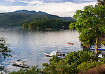 The Lembeh Resort's dive boat fleet waits at anchor as dusk approaches.