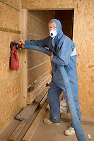 Pentre Solar village in Glanrhyd, North Pembrokeshire, is a environmentally friendly social housing project which will provide housing for tenants off the council housing register in Pembrokeshire.<br /> <br /> Picture shows Paul Oxborrow of Western Solar Ltd using a machine to fill a wall cavity with insulation material made from recycled paper.